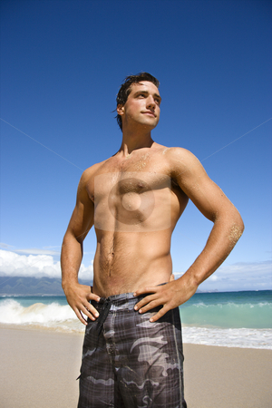 Attractive man. stock photo, Handsome man standing on Maui, Hawaii beach. by Iofoto Images