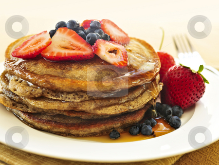 Stack of pancakes stock photo, Stack of buckwheat pancakes with fresh berries and maple syrup by Elena Elisseeva