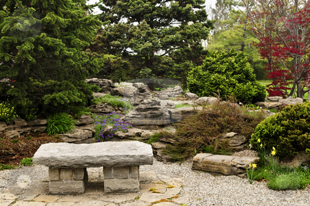 Zen garden stock photo, Japanese zen garden with natural stone bench by Elena Elisseeva