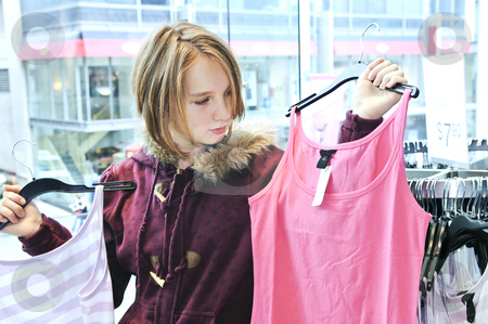 Teenage girl shopping stock photo, Teenage girl shopping for clothes and accessories by Elena Elisseeva