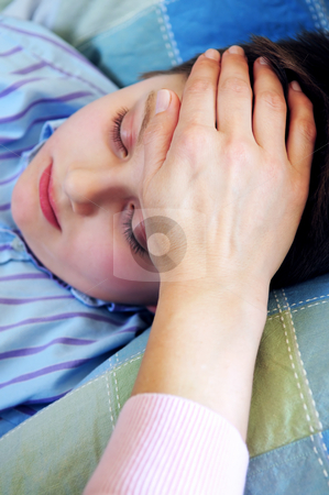 Sick child stock photo, Mother's hand feeling the forehead of a sick child by Elena Elisseeva