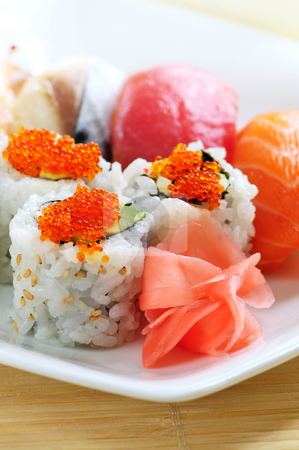 Sushi and california rolls stock photo, Sushi and california rolls on a plate close up by Elena Elisseeva