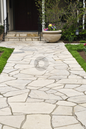 Natural stone path stock photo, Natural stone path leading to a house, landscaping element by Elena Elisseeva