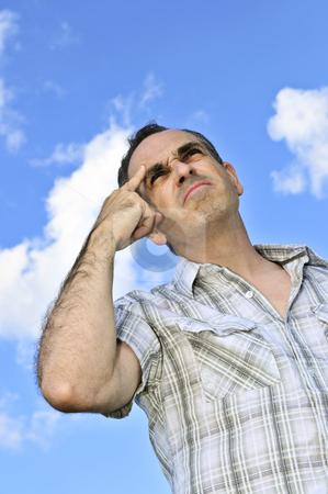 Man thinking stock photo, Portrait of middle aged man thinking hard by Elena Elisseeva
