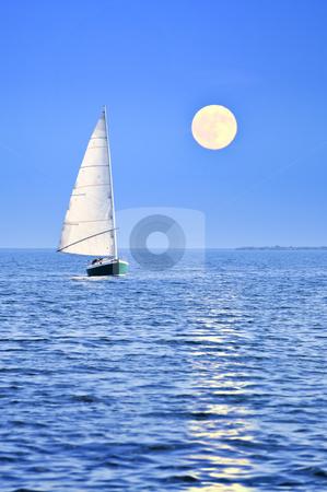 Sailboat at full moon stock photo, Sailboat sailing in a sea at full moon night by Elena Elisseeva