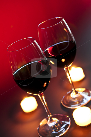 Wineglasses stock photo, Two wineglasses with red wine at candlelight by Elena Elisseeva