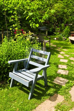 Green garden stock photo, Path of stepping stones leading into lush green garden by Elena Elisseeva