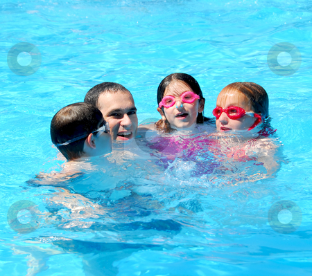 Family fun pool stock photo, Family having fun in swimming pool by Elena Elisseeva