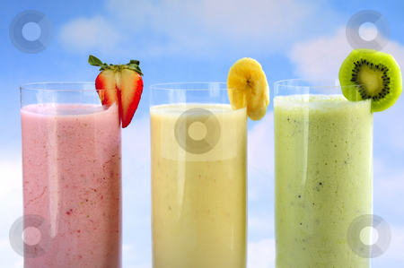 Assorted fruit smoothies stock photo, Assorted fruit and berry smoothies on blue sky background by Elena Elisseeva
