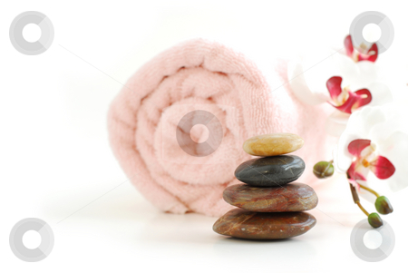 Spa stock photo, Pink rolled up towel with a stack of massage stones and orchid on white background by Elena Elisseeva