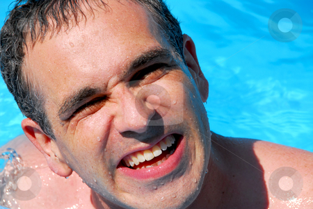 Man swim pool stock photo, Portrait of a laughing man in a swimming pool by Elena Elisseeva