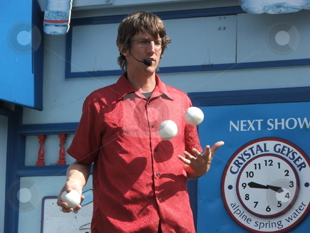 Boardwalk juggler stock photo, A juggler entertains in a free show on a Fisherman's Wharf open air stage in San Francisco.   Fisherman's Wharf is rated the top tourist attraction in San Franciso. by Dennis Thomsen