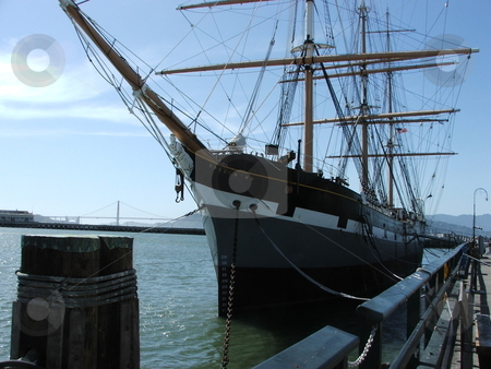 The 1886 square-rigged ship Balclutha stock photo, The 1886 square rigger Balclutha is one of several ships displayed in the San Francisco Maritime National Historic Park located at the old Hyde Park Pier near Fisherman's Wharf.  The ship was built in Scotland and used to carry a variety of cargo around the world. by Dennis Thomsen