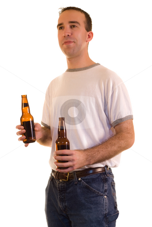 Holding Beer stock photo, A young man holding two beer, isolated against a white background by Richard Nelson