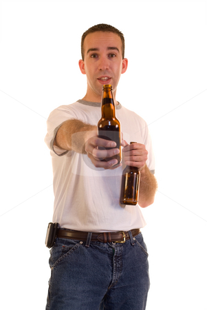 Offering A Beer stock photo, A young man offering someone a beer by Richard Nelson