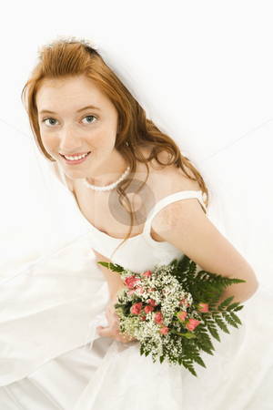 Bride holding bouquet. stock photo, Portrait of a Caucasian bride holding bouquet. by Iofoto Images