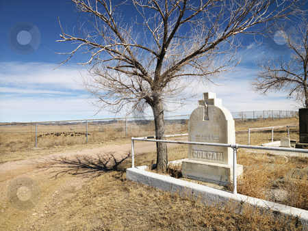 Headstone in cemetery. stock photo, Headstone at the corner of a cemetery. by Iofoto Images