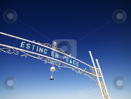 Graveyard entrance. stock photo, Gate entrance to graveyard reading esting in peace. by Iofoto Images