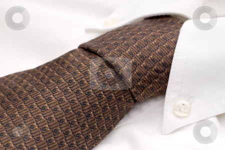 Shallow focus close-up of a white dress shirt and tie stock photo, Shallow focus close-up of a white dress shirt and tie by Vince Clements