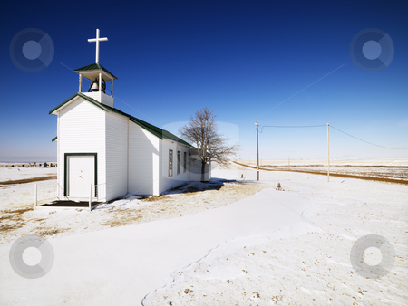 Small white church. stock photo, White small church with snow covered ground in foreground. by Iofoto Images