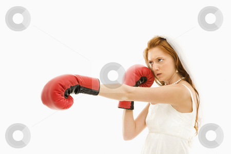 Bride with boxing gloves. stock photo, Caucasian bride with boxing gloves. by Iofoto Images