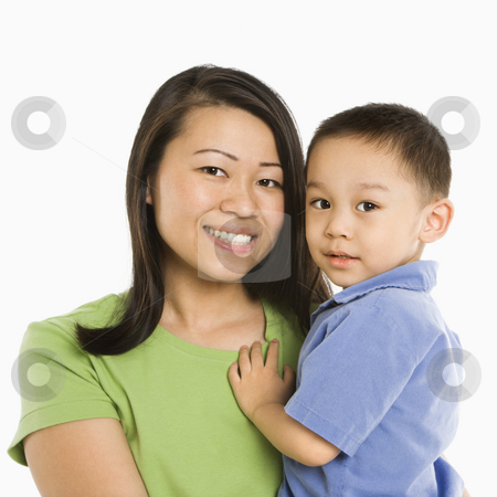 Mother holding son. stock photo, Asian mother holding son smiling in front of white background. by Iofoto Images
