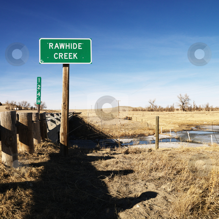 Rawhide creek sign. stock photo, Rawhide creek sign in rural landscape. by Iofoto Images