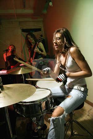 Girl band. stock photo, Caucasian girl band playing instruments. by Iofoto Images