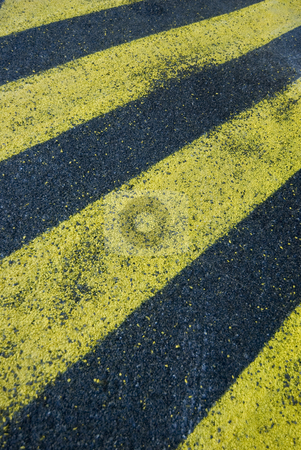 Yellow stripes stock photo, Yellow hatched stripes on asphalt, symbolic of a no-go area by Stephen Gibson