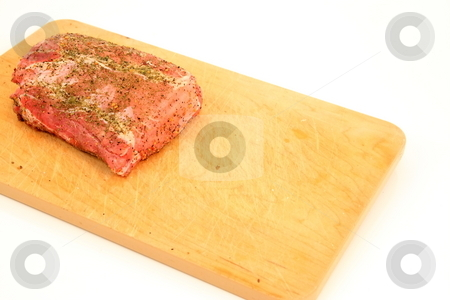 Pork Roast stock photo, Pork Roast on wooden cutting board seasoned and ready to cook by Jack Schiffer