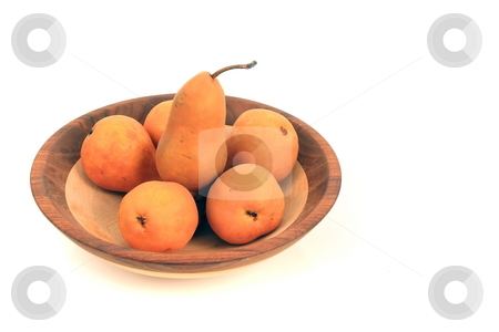 Bosc Pears stock photo, Bosc pears in a wooden bowl display by Jack Schiffer