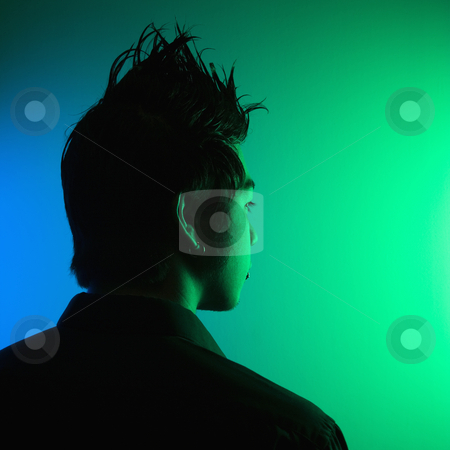 Young man with spiked hair. stock photo, Portrait of attractive young Asian man with spiked hair. by Iofoto Images