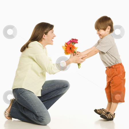 Son giving mother flowers. stock photo, Son giving bouquet of flowers to mother. by Iofoto Images