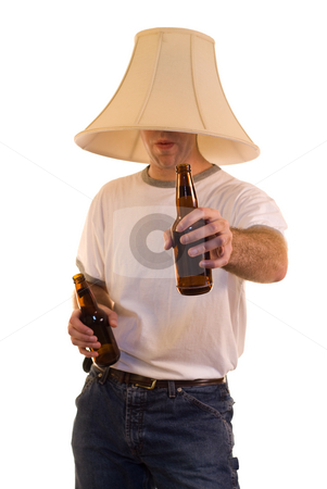 Party Time stock photo, A young man wearing a lamp shade on his head offering a beer by Richard Nelson