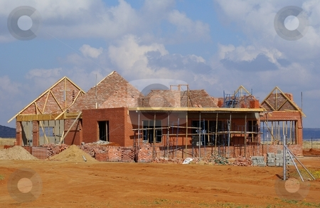 House Under Construction stock photo, A house under construction in a new housing development by Martie Venter