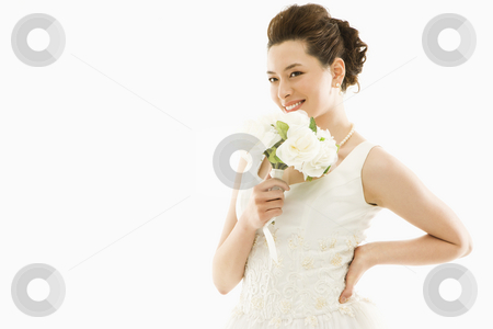 Bride with bouquet. stock photo, Portrait of Asian bride with bouquet. by Iofoto Images