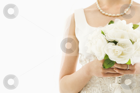 Bride with bouquet. stock photo, Close up shot of an Asian bride holding bouquet. by Iofoto Images