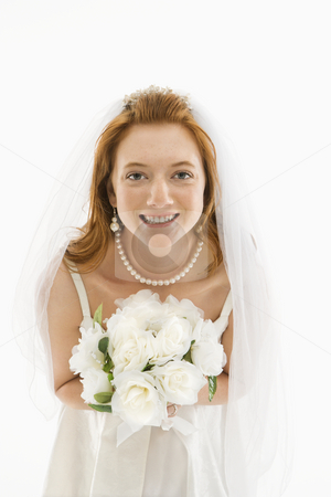 Bride holding bouquet. stock photo, Portrait of Caucasian bride holding bouquet. by Iofoto Images