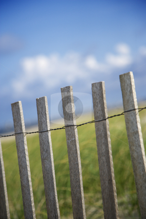 Weathered wooden fence on sand dune. stock photo, Weathered wooden fence on sand dune. by Iofoto Images