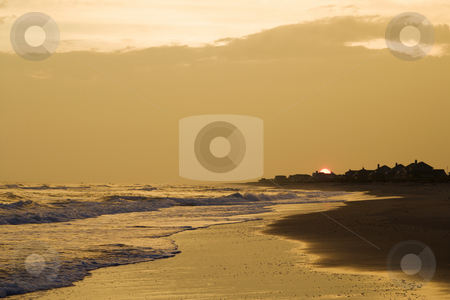 Golden beach at sunset. stock photo, Golden beach at sunset. by Iofoto Images