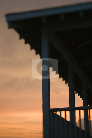 Beachfront porch silhouetted at sunset stock photo, Beachfront porch silhouetted at sunset by Iofoto Images