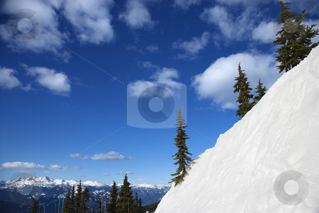 Snow covered mountain side. stock photo, Scenic of snow-covered mountain side. by Iofoto Images