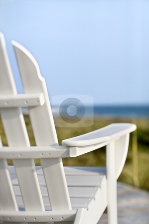 Adirondack chairs pointing toward ocean. stock photo, Adirondack chairs on deck looking towards beach on Bald Head Island, North Carolina. by Iofoto Images