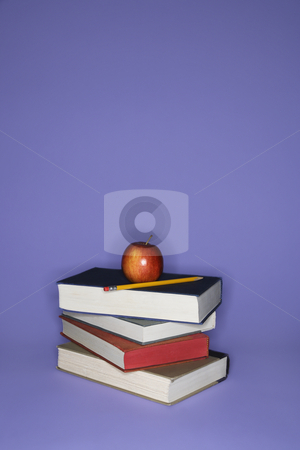 Books with apple and pencil. stock photo, Stack of books with apple and pencil. by Iofoto Images
