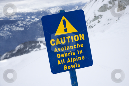 Snow ski caution sign. stock photo, Snow ski resort caution sign on mountain side. by Iofoto Images
