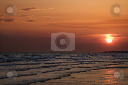 Sun setting over beach. stock photo, Sun setting over beach on Bald Head Island, North Carolina. by Iofoto Images