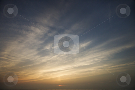 Sunset sky. stock photo, Wispy clouds at sunset. by Iofoto Images