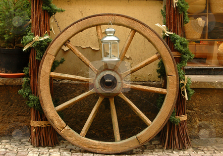 Wheel stock photo, Close up on wooden wheel on Prague street by Kobby Dagan