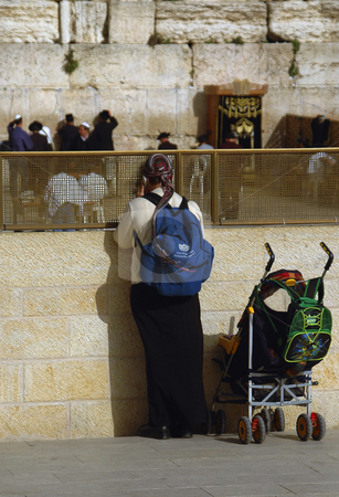 Westren Wall stock photo, Woman in the westren wall in jerusalem by Kobby Dagan