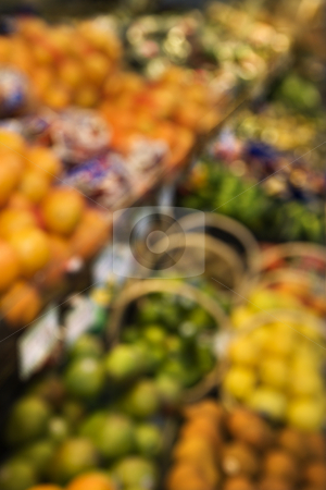 Produce at grocery store. stock photo, Blurred fruit stacks at grocery store. by Iofoto Images